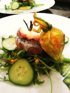 Warm goats cheese salad with ricotta and walnut stuffed courgette flower.